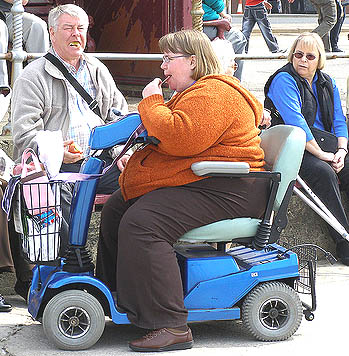 Fat_woman_on_scooter_312380725